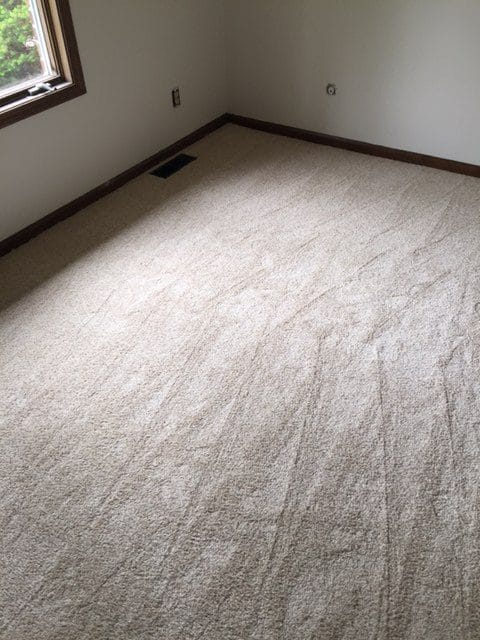 Bedroom carpet installation by Greentown Flooring